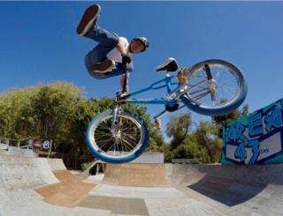 John still loves to ride his BMX
