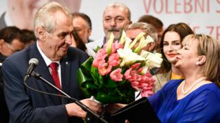 Czech President Milos Zeman (L) and his wife Ivana Zemanova (R) receive a buoquet of flowers as they celebrate his victory in the presidential election run-off in Prague, Czech Republic, 27 January 2018.