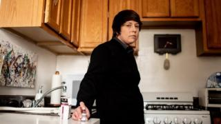 Laura Marston stands in her kitchen, where she stores insulin in a quarter of her fridge