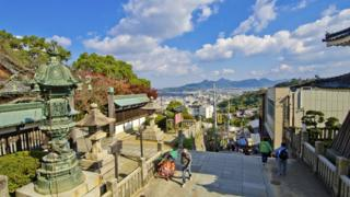 The steps leading up to Korohira shrine with a panorama in the background