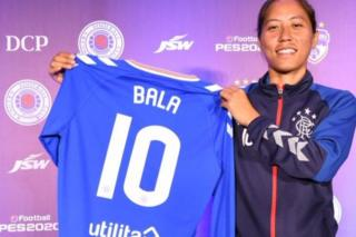 Ngangom Bala Devi holding her Rangers jersey