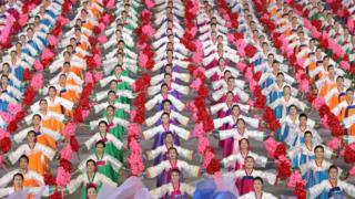 """In a photo taken on September 19, 2018 performers dance during a """"mass games"""" gymnastic and artistic performance"""