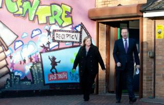 Head of the Troubled Families Unit, Louise Casey (l), walks with former British Prime Minister David Cameron (r) in Birmingham in December 15, 2011