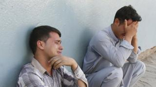 People react after a suicide bomb attack targeting Shiite Muslims Mosque during Friday congregational prayers, in Kabul, Afghanistan, 29 September 2017. A