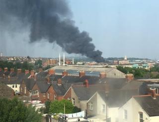 Black smoke rising from garage fire