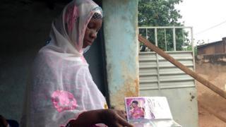 Aissatou Sanogo shows photos of her husband