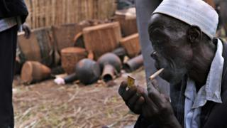 Ugandan man smoking