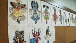Photograph of sketches of Paraiso do Tuiuti samba school costumes