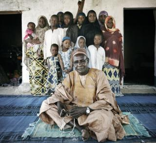 Ibrahim Sanda, chief of the village of Sarki, hosts 19 women and children in his home, Mokolo, extreme-north Cameroon.