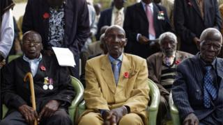 Kenyan war veterans observe Remembrance Sunday at the Nairobi War Cemetery in Kenya, Sunday, Nov. 13, 2016. The annual event is observed in Britain and around the Commonwealth to honor the contribution of those British and Commonwealth military who died in the two World Wars and later conflicts.