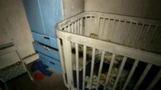 Burnt out child's cot