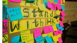 Messages of support on post-it notes stuck on a poster board