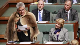 Ken Wyatt, wearing a traditional kangaroo skin coat, delivers his maiden speech in parliament