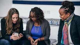 Christina Sass (left) with Andela employees