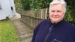 Marjorie Sullivan outside her house