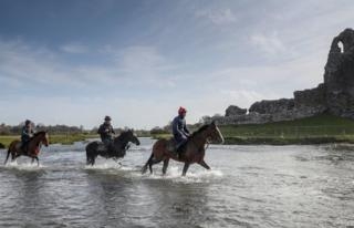 """Horses from Christian Williams"""" stables in the river next to Ogmore Castle at his yard in Glamorgan. PA Photo. Picture date: Saturday March 21, 2020. All horse racing fixtures in Great Britain have been suspended until the end of April because of the coronavirus outbreak."""