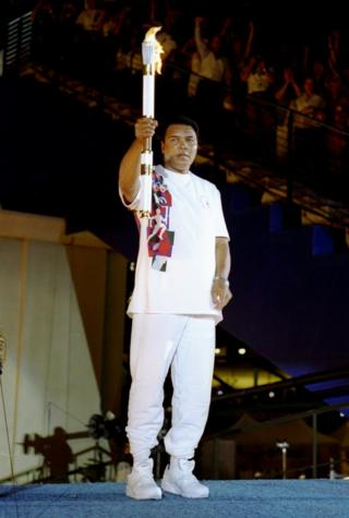 Muhammad Ali with the Olympic flame in 1996