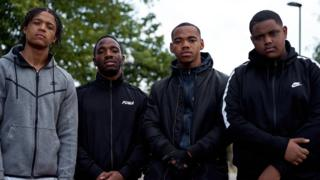 Percelle Ascott, Konan, Joivan Wade and Deno Driz posing for a behind the scenes shot