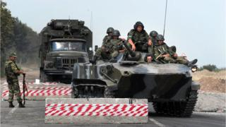 Russian armoured vehicle passing a checkpoint on the Gori-Tbilisi road near the village of Khurvaleti on August 22, 2008.