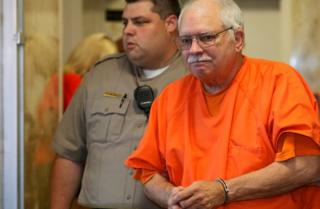 Robert Bates, a former Oklahoma volunteer sheriff's deputy, is escorted from the courtroom following his sentencing in Tulsa, Oklahoma, on 31 May