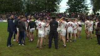 Crowds at the Derry GAA final, with the team in the foreground