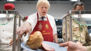 The PM served turkey and Yorkshire puddings in the base's canteen