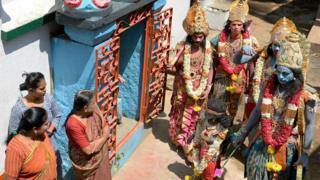 Indian men dressed as Hindu gods