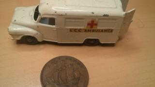Picture of a Matchbox car and a halfpenny, representing what John buried in his time capsule