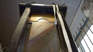 A guillotine is pictured in its auction room in Nantes, western France, on March 25, 2014.