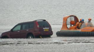 Car submerged in the tides at Brean