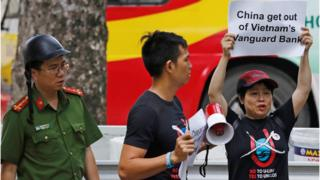 Protester in front of Chinese Embassy in Hanoi