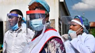 Medical staff at the Chandaria Health Centre try on face shields in Nairobi, Kenya - 14 May 2020