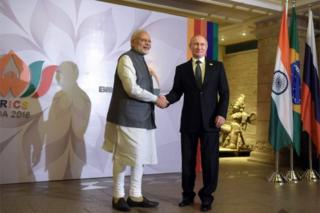 Russian President Vladimir Putin (R) shakes hands with Indian Prime Minister Narendra Modi (L) prior to a meeting of BRICS leaders and heads of delegations of the Bay of Bengal Initiative for Multi-Sectoral Technical and Economic Cooperation (BIMSTEC) member states at Leela Goa hotel in Goa, India, 16 October 2016.