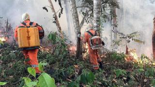 Firefighters shows a fire at the Brazilian Amazonia
