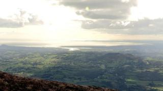 The view of the surrounding countryside and Carlingford Lough from the top of Slieve Gullion