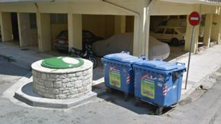 Google street view shows two bins and a large stone rubbish chute
