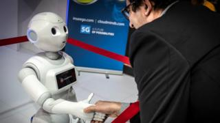 cloudmind-robot-shakes-hands-with-man