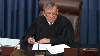 Supreme Court Chief Justice John Roberts presides over impeachment proceedings