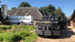 sports Stables with an armoured vehicle in front