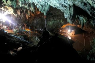 Thai officials work to reduce the water level in a cave complex at the Tham Luang cave
