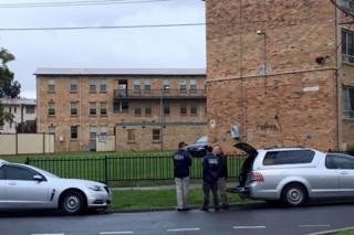 Police officers outside apartments in Melbourne's northern suburbs