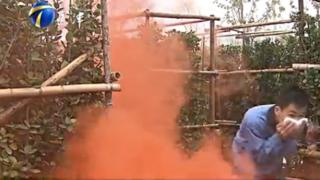 A man going through the smoke-filled maze