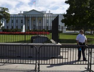 A Secret Service police officer stands outside the White House in Washington, on 22 September, 2014.