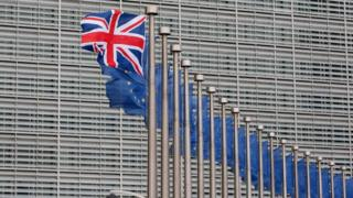 British and European Union Flags outside the European Commission in Brussels