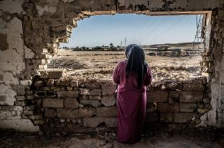 Woman in her home in Iraq