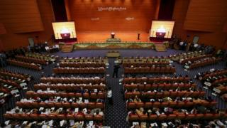 Myanmar's President Thein Sein gives a speech to the hall