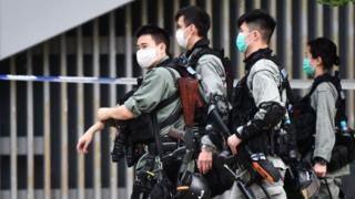 Riot police stand guard outside the Legislative Council in Hong Kong on May 27, 2020