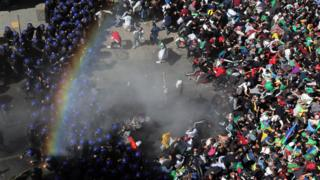 Police fire tear gas at crowds in Algeria
