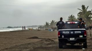 Police patrol beach in Mexico