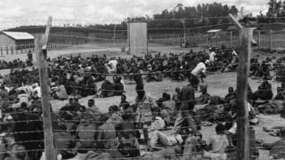 Suspected Mau Mau activists in a prison camp